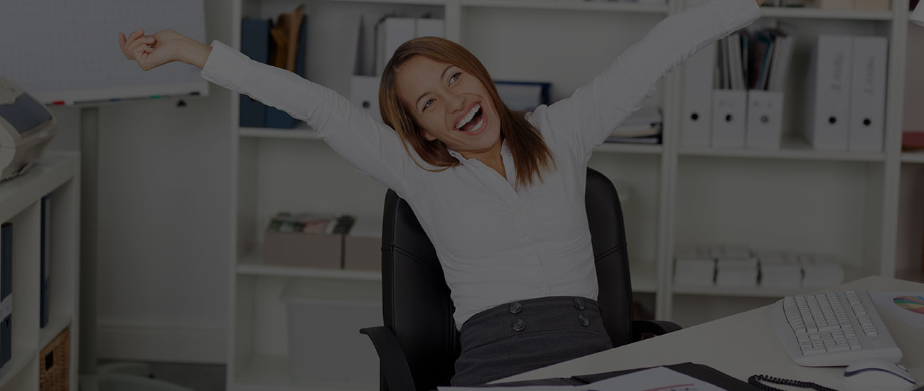 women celebrating at desk
